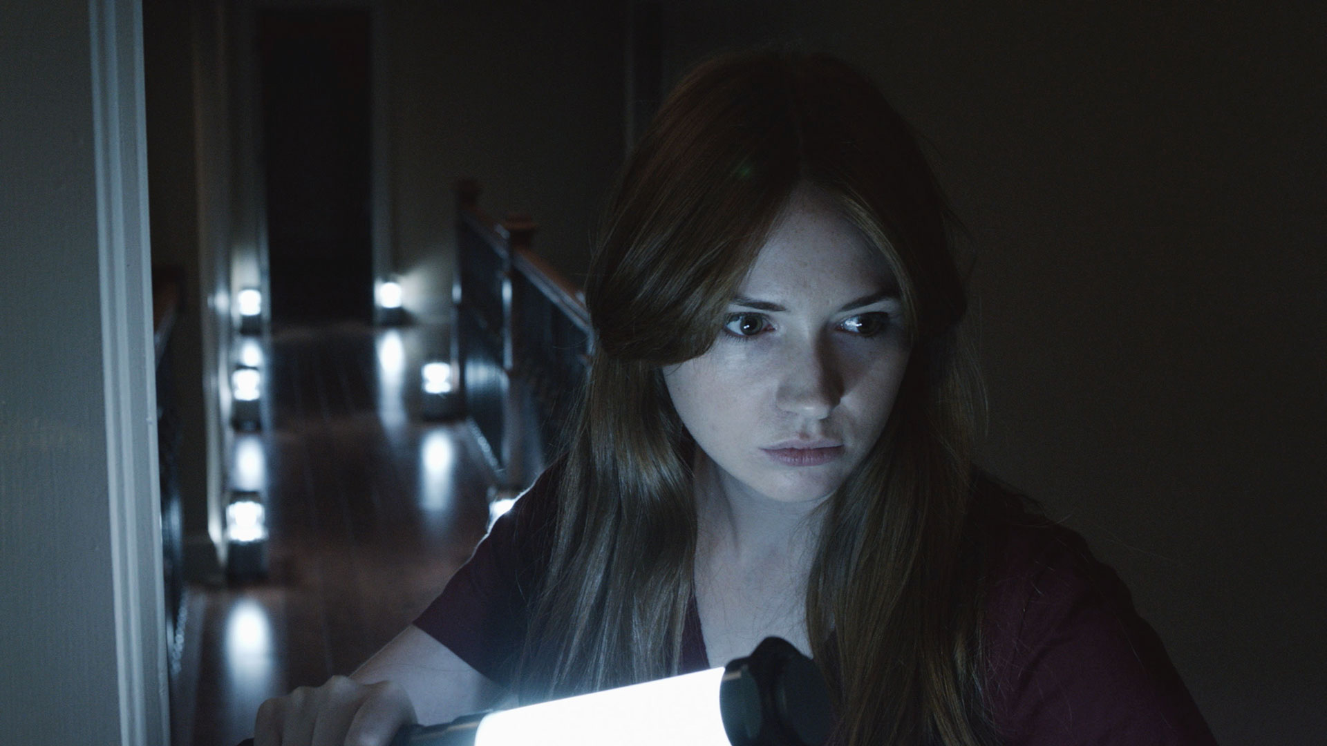 Kaylie (Karen Gillan) plans to rid the family of the Lasser glass curse in OCULUS.