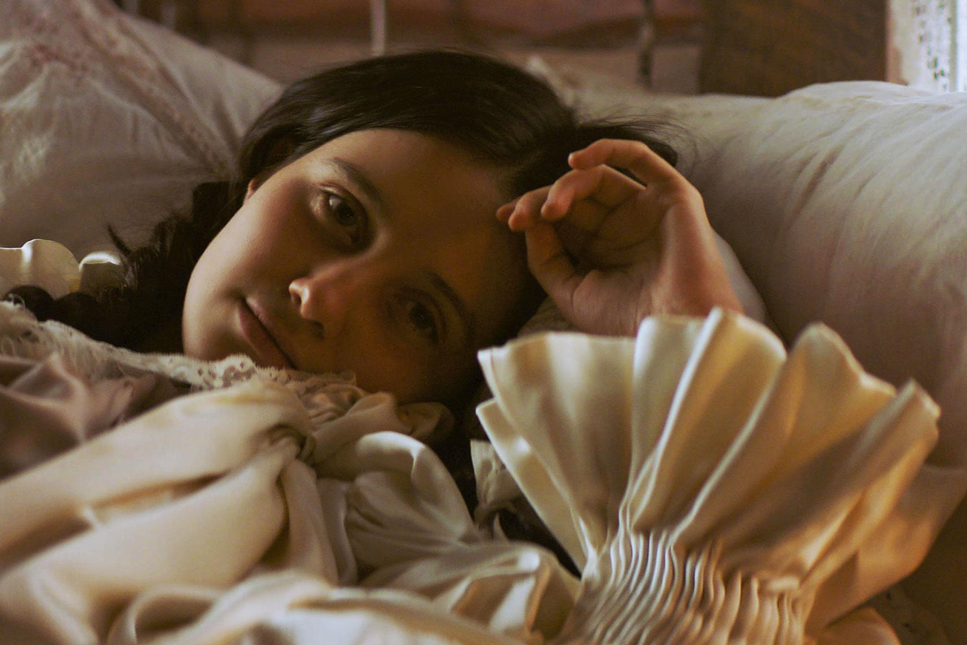 Emma (Julia Goldani Telles) seems resigned to her fate.